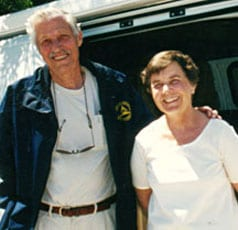 George and Ann Burkwell pictured next to their custom Sportsmobile camper conversion van.