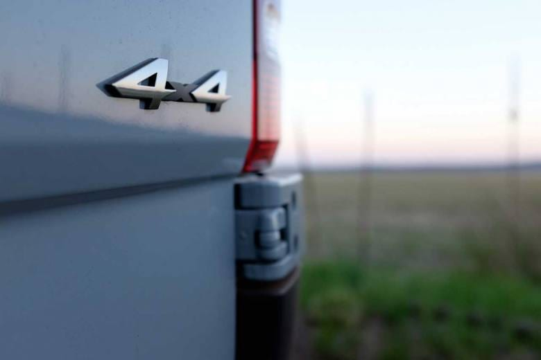 A close up of a custom Sportsmobile Sprinter 4x4 camper emblem.