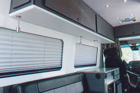Van conversion with upgraded cabinets and leather gaucho.