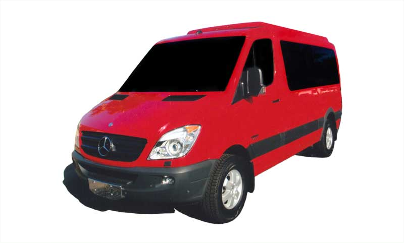 A red custom Sportsmobile Sprinter camper conversion featuring penthouse pop top that is in the closed position.