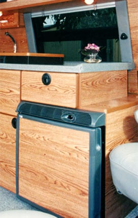 Product image of a refrigerator that is used in Sportsmobile conversion vans.