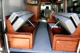 Interior view of extra storage space under dinettes in a Sportsmobile van conversion.