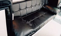 Interior view of a Gaucho that seats four in a Sportsmobile van conversion.