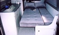 Interior view of a Gaucho in a Sportsmobile van conversion.