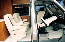 Image of various adjustments with Captain seats in a Sportsmobile van conversion.
