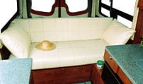 Interior view of sofa that sleeps three in a Sportsmobile van conversion.
