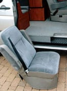 Image of removable Captain seats in a Sportsmobile van conversion.
