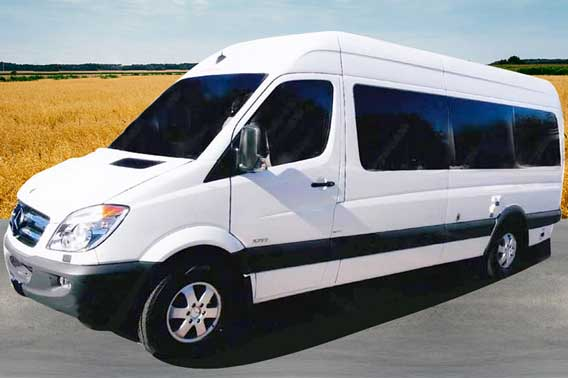 Custom white extended body Sprinter van conversion.