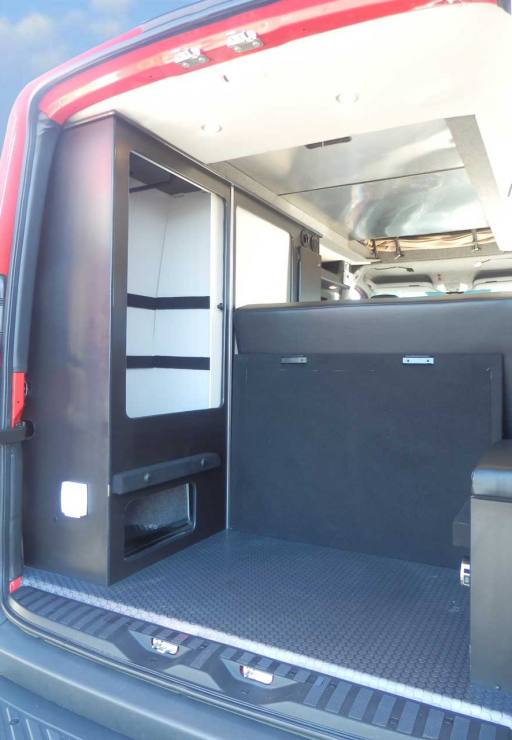 Sportsmobile camper van converison with plenty of storage in the rear.