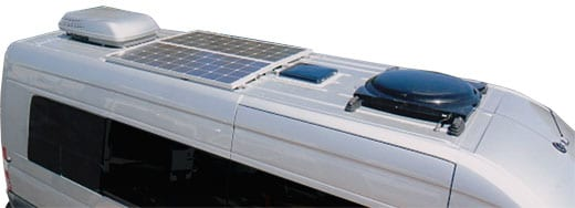 An aerial view of the top of a Sportsmobile van conversion with solar panels attached to its roof.