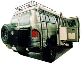 View of the backend of a custom Sportsmobile conversion with ladder.