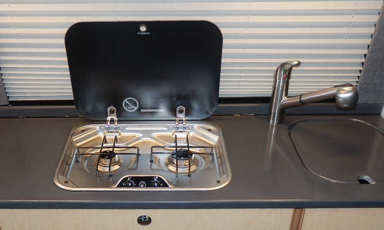Sportsmobile custom van choices - refrigerators and cooktops.