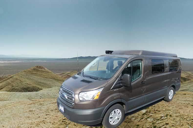 Brown Transit camper conversion van with the Penthouse top up.