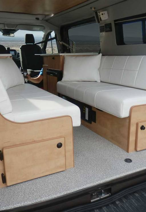 Interior Transit camper view with white dinette.