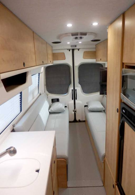 Ford Transit camper conversion with full walkway.