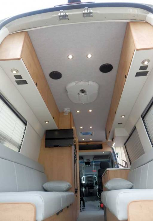 Ford Transit camper conversion with dinette that converts into beds.