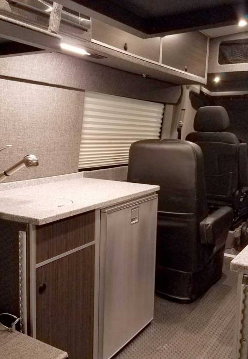 Plenty of storage space and room in this van conversion.