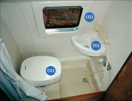 Interior view of combo shower and toilet in a Sportsmobile conversion van.