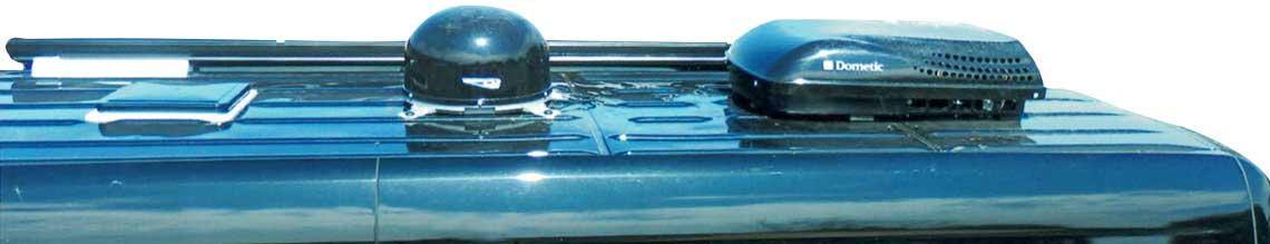 TV satellite on top of a black Sportsmobile custom conversion van.