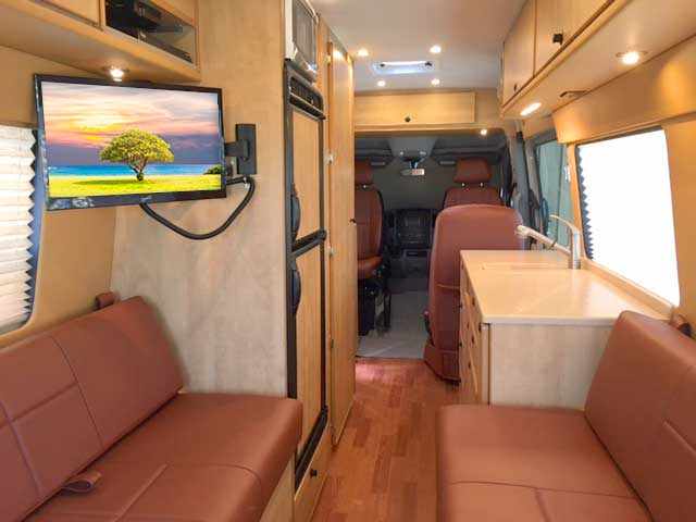 Van interior options entertainment tv satellite internet audio for Commercial van interior accessories