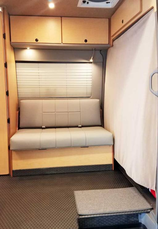 The small gaucho can convert into a single bed. A cab privacy curtain is included.