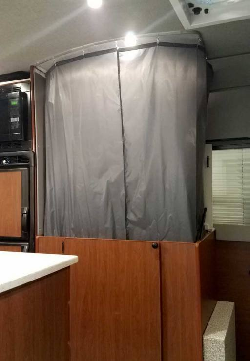 Interior shower view of a Sportsmobile Sprinter EB custom camper van conversion.