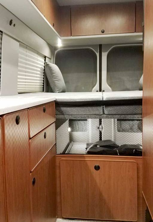 Interior view of a Sportsmobile Sprinter EB custom camper van conversion.