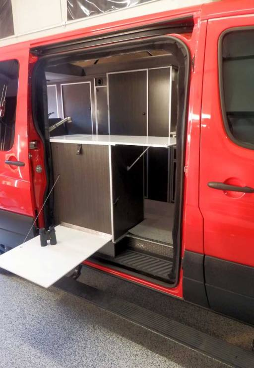 Custom Red RB-50M Sportsmobile Sprinter with outside access to the galley.