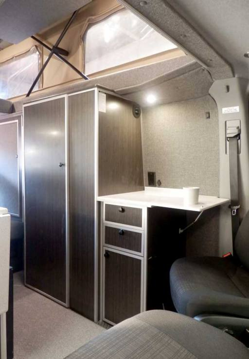 Custom Red RB-50M Sportsmobile Sprinter with interior galley.