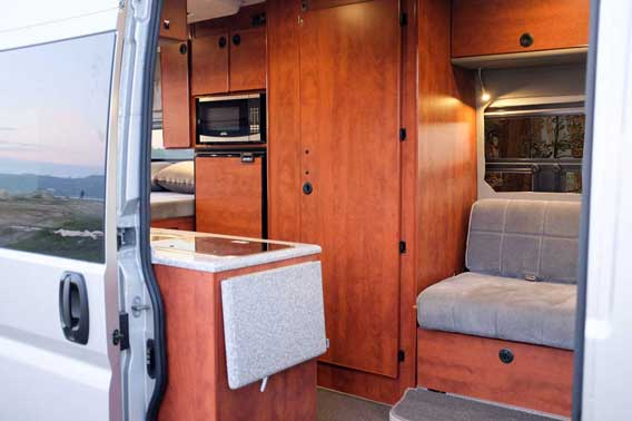 Custom van conversion outfitted with upgraded cherry cabinets.