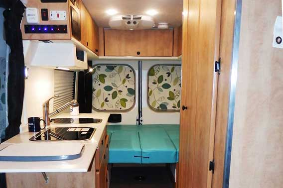 Van conversion with modern color scheme and upgraded materials.