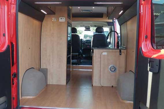 Plenty of storage space in the back of camper van conversion.