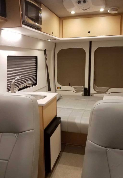 Interior view of a custom Sportsmobile Transit conversion van with high roof.
