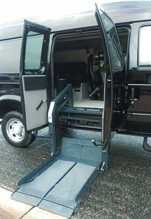 Sportsmobile Disabled Transit 4x4 with hydraulic ramp system in down position.