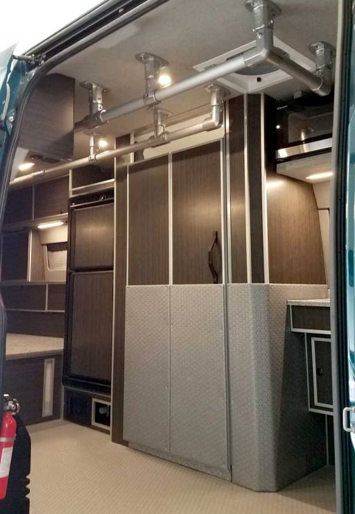 Interior view of a Sportsmobile Sprinter of hidden bathroom.