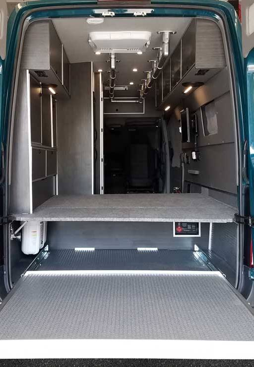 Exterior view of a Sportsmobile Sprinter rear entry.