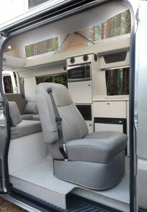 Custom Mercedes-Benz conversion van with slide door open and penthouse pop top extended.