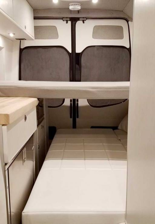 Custom Sprinter conversion van with a removable platform bed.