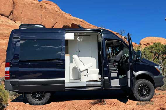 Dark blue Sprinter 4x4 Van conversion in the desert.