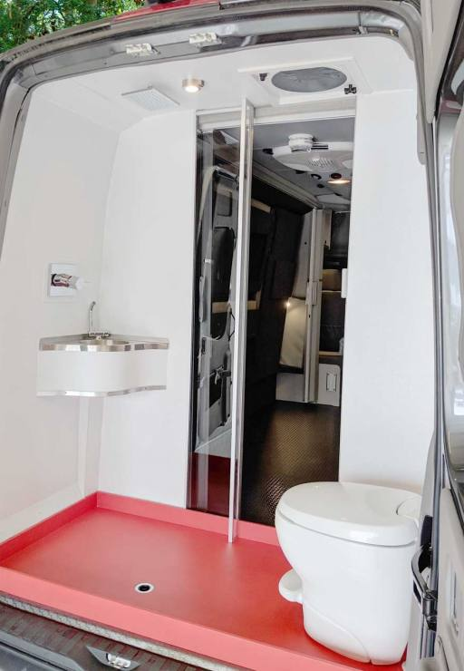 Bath area in the rear of van with shower and toilet.