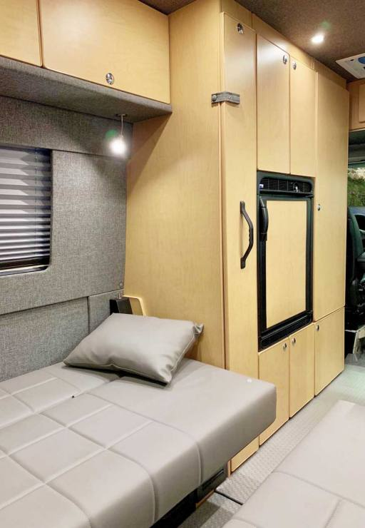 Dinette folds out to make 2 single beds.
