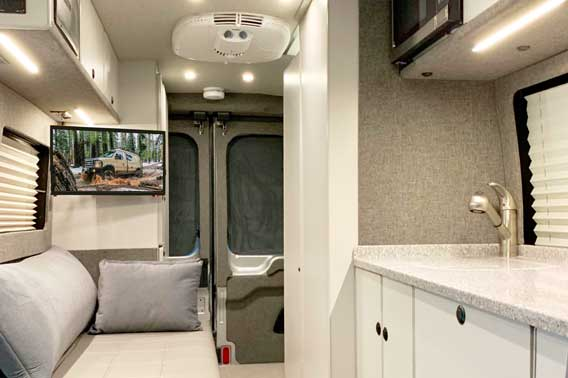 Van conversion with modern interior and amenities.