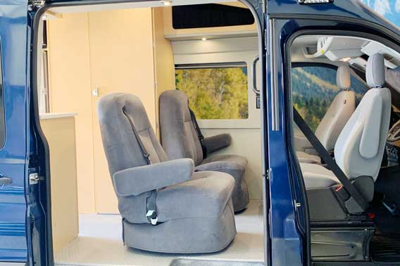 Upgraded van conversion upholstery and cabinet materials.