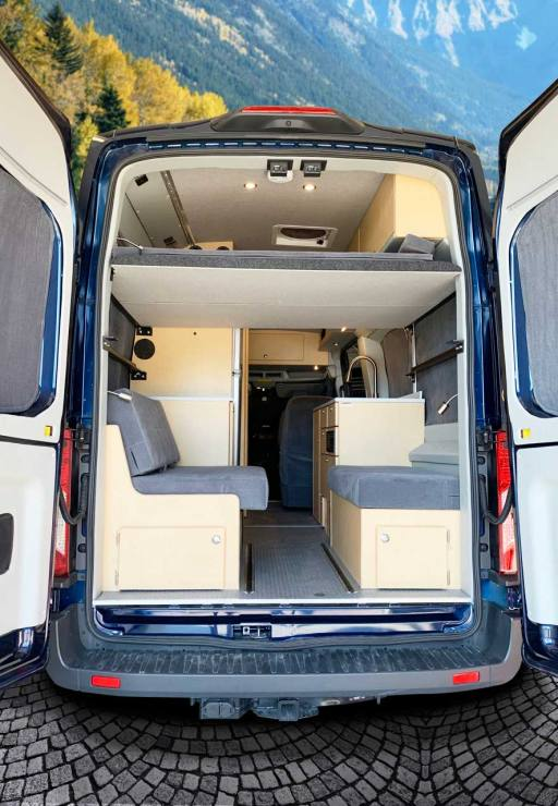 Platform bed in rear of conversion van.