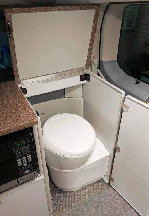 Out of site cassette toilet in rear compartment.
